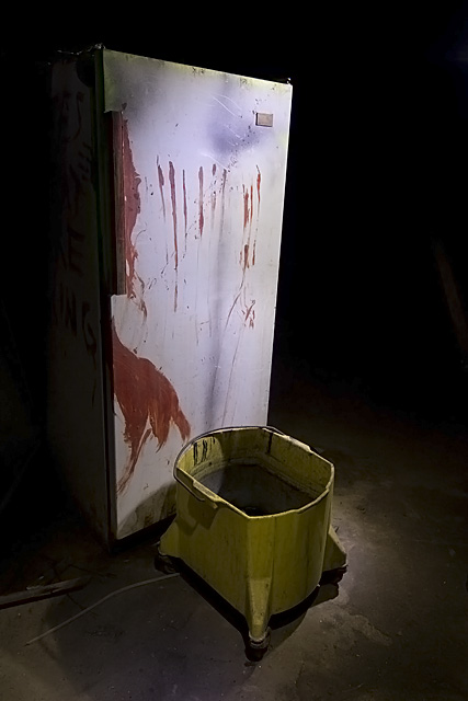 Dahmer  :::::  Blood-covered Fridge in theHaunted House's kitchen.