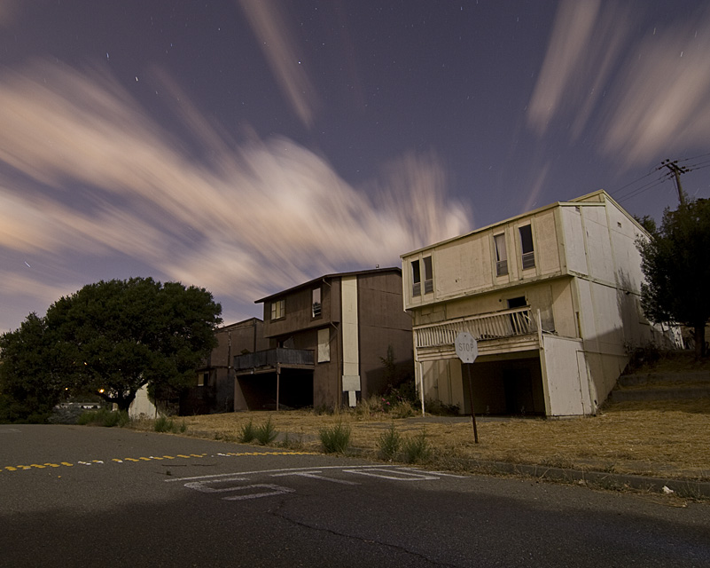 Stop Living Here  :::::  Dozens of these dilapidated '70s townhouses dotted the overgrown hills.