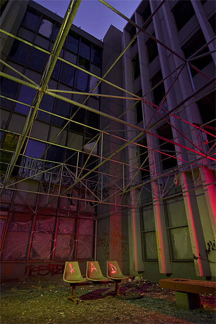 AAD  :::::  The roof-top exercize yard, where every step crackled broken glass.