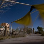 The Food Court Flutter  :::::  Most of the canopies at the Lazy River Cafe are gone, only a few remnant's remain, thrashing themselves to shreds in the endless high-desert wind.