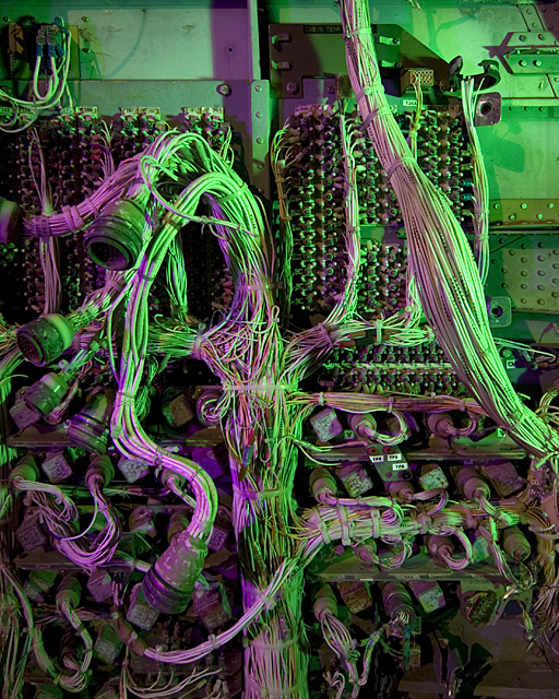 Robot Barf  :::::  2006  :::::  Miles of wiring hangs from the cockpit bulkhead of a junked 1960s airliner.