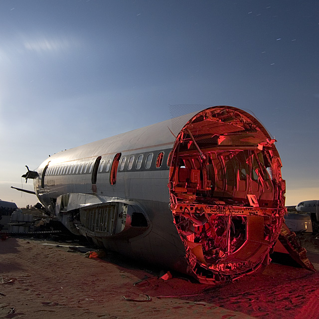 Clipped and Headless  :::::  2006  :::::  A severed Delta 727 fuselage on its belly in the sand.