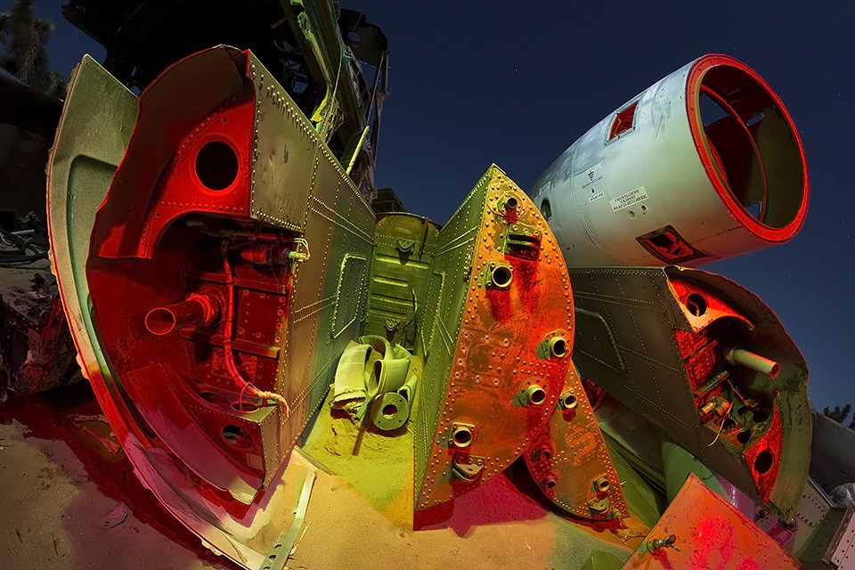 Earth Here  :::::  2014  :::::  Fighter jet fuselage and fuel tanks, sparkling in the sand.