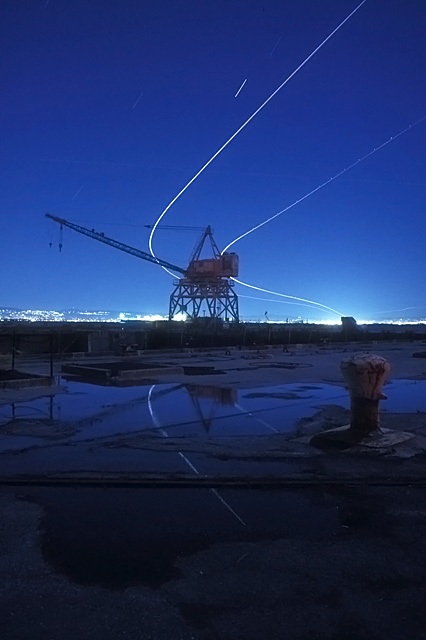 Air Traffic  :::::  An abandoned drydock gantry crane under the OAK departures path.