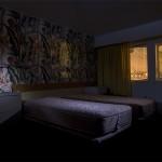 Bedside  :::::  One of hundreds of staterooms.