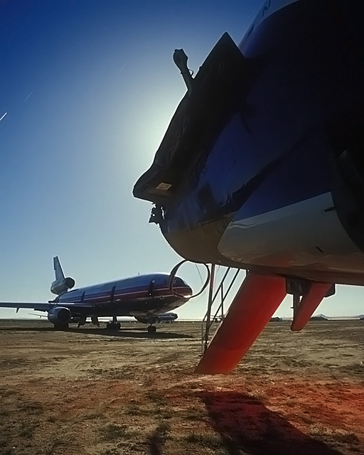 Nose Ring  :::::  2003  :::::  FedEx 727 rear stairs and an American Airlines DC-10.