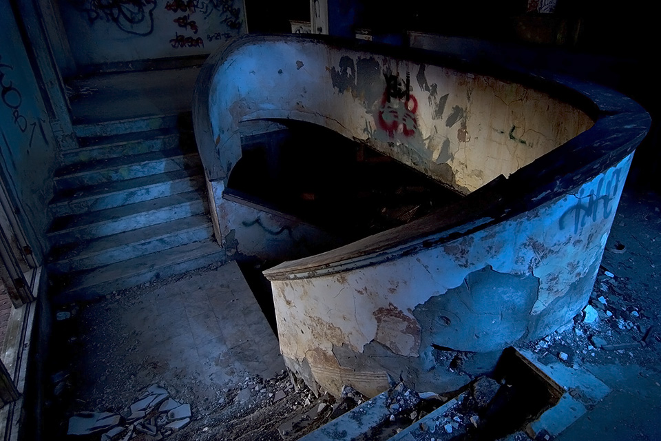 Watch Your Step  :::::   From the second-floor landing, the battered grand staircase glows in the last moments of twilight.